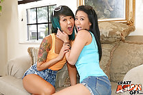 Saya Song and friend Sonia embracing on sofa tattoo on shoulder