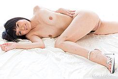 Lying On Bed Knee Raised Exposing Her Pussy Wearing High Heels