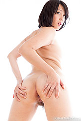 Looking Over Her Shoulder Hands On Her Ass Spreading Nude