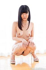 Squatting Nude Hands On Knees Wearing High Heels