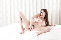 Asagiri Akari fingering her pussy long hair naked on bed bare feet
