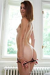 Lowering Her Panties Biting Her Lip Exposing Her Nice Ass Small Tits