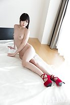 Aoi Shino seated on bed nude small breasts wearing red high heels